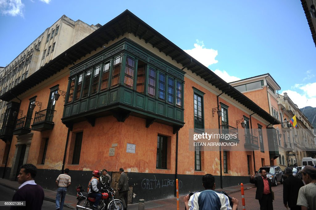 People walk down the streets in the historic neighborhood of La Candelaria in Bogota on September 17, 2009