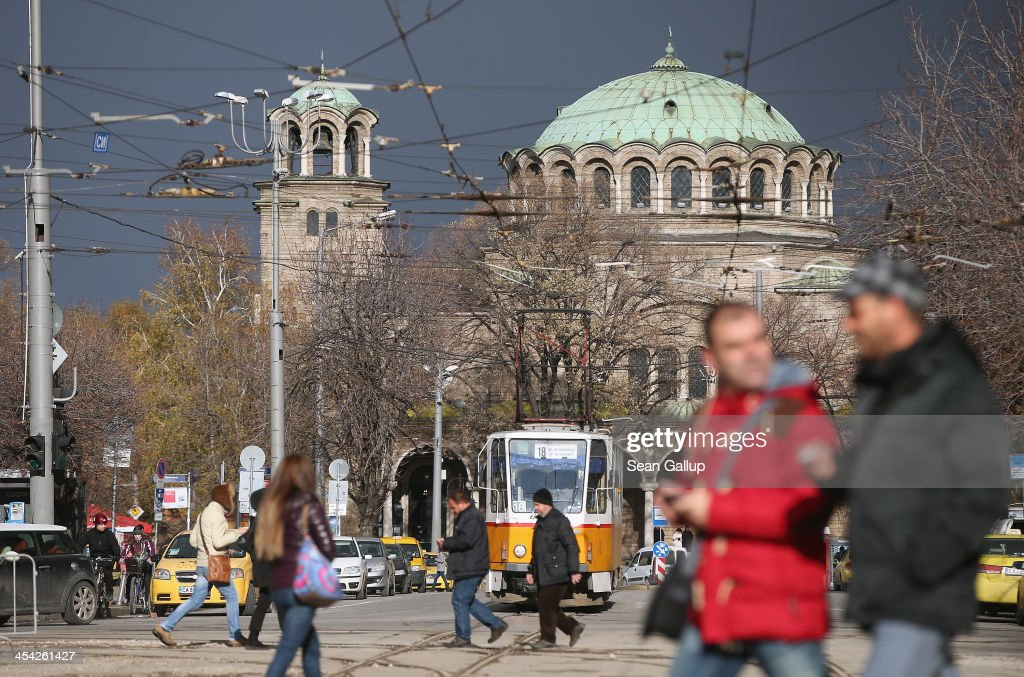 People walk down the Vitosha Boulevard shopping street as the St Nedelya Eastern Orthodox church stands behind on December 7, 2013 in Sofia, Bulgaria. Restrictions on the freedom of Bulgarians and Romanians to work in the European Union are due to run out by December 31, though several EU leaders, including British Prime Minister David Cameron, are considering imposing temporary restrictions to cut the flow of Romanians and Bulgarians arriving in EU countries. Many EU nations have voiced concern over too many Bulgarians and Romanians arriving and applying for social benefits. Romania and Bulgaria are both EU members though their citizens do not yet receive the same rights as citizens of other EU nations.