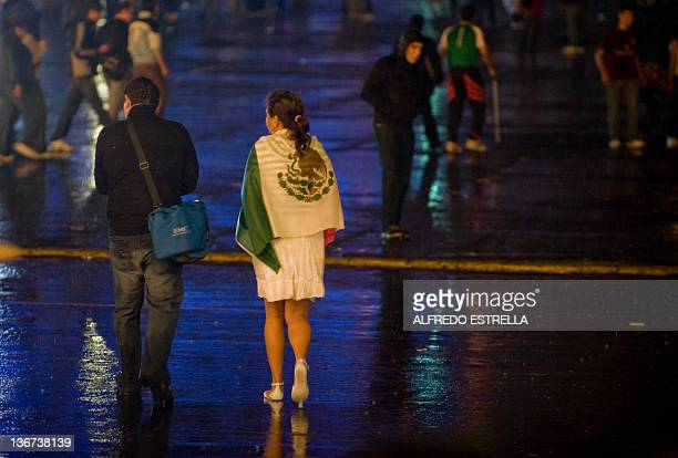 People walk during celebrations marking the 201st anniversary of Mexico's Independence from Spain on September 15 2011 in Mexico City The...