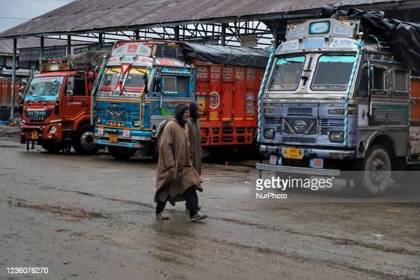 "People walk during rainfall at Fruit Mandi in Sopore, District Baramulla, Jammu and Kashmir, India on 23 october 2021. ""Light to moderate rain..."