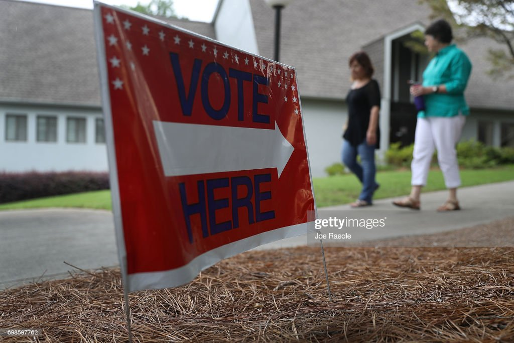 People walk from a polling place as ballots are cast during a special election in Georgia's 6th Congressional District at North Fulton Government Service Center on June 20, 2017 in Sandy Springs, Democrat Jon Ossoff and Republican Karen Handel are vying to replace Tom Price, who is now the Secretary of Health and Human Services. The election will fill a congressional seat that has been held by a Republican since the 1970s.