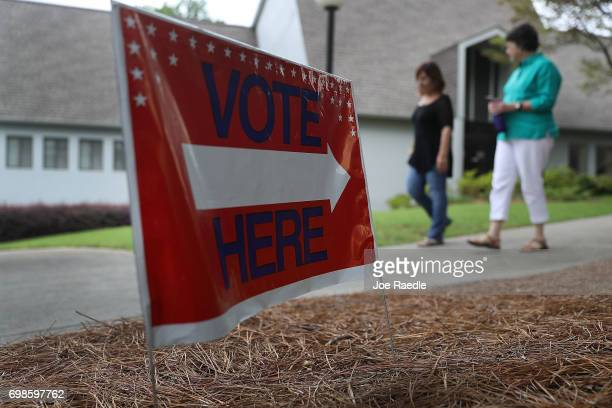 People walk from a polling place as ballots are cast during a special election in Georgia's 6th Congressional District at North Fulton Government...