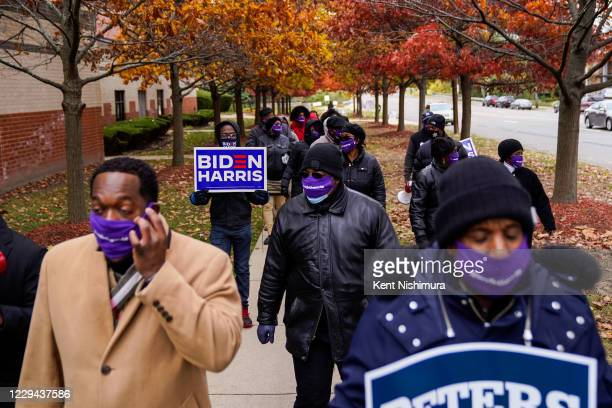 People walk from Greater Grace Temple towards the Five Points neighborhood on Sunday, Nov. 1, 2020 in Detroit, MI. With only days remaining before...