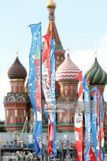 People walk front of flag with the logo of the FIFA World Cup 2018 in Moscow before the 2018 FIFA World Cup Russia in Moscow Russia on June 2018 The...
