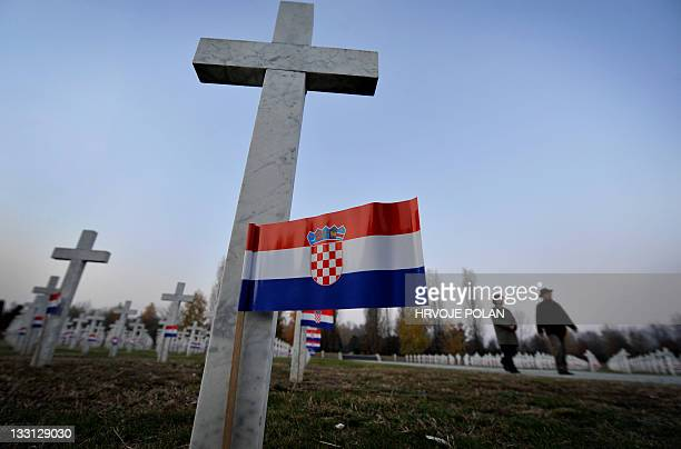 People walk in a cemetery for 1991 war victims in the eastern Croatian city of Vukovar on November 17 a day before the 20th anniversary of the...