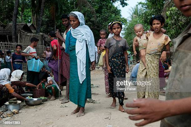 People walk in a market in Paungdok a Rohingya village with about 500 hourses and 5000 people