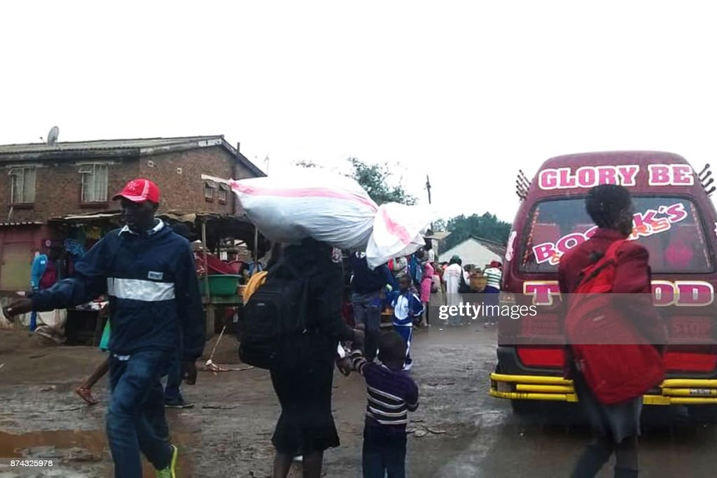 People walk in a market in the Zimbabwean capital Harare on