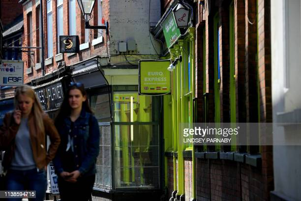People walk in a street in Boston in Lincolnshire northeast England April 18 2019 Boston registered Britain's strongest support for Brexit but nearly...