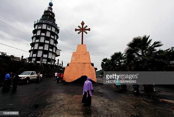 People walk in a street inside the Nueva Jerusalen religious community where in the last month the catholic sect in charge of the community destroyed...