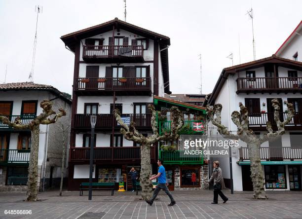 People walk in a street of the northern Spanish Basque village of Hondarribia on February 23 2017 When he was a kid in Hondarribia Unai Emery could...