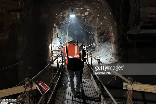People walk in a tunnel of the East Side Access project one of the largest transportation infrastructure projects currently underway in the United...