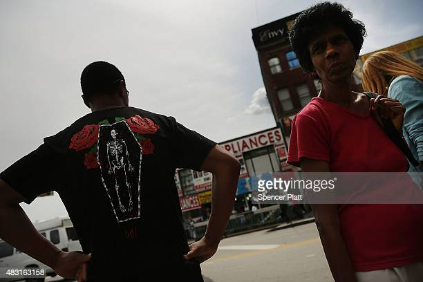 People walk in an area of the Bronx which is the center of the outbreak Legionnaires disease on August 6 2015 in New York City It is believed that...