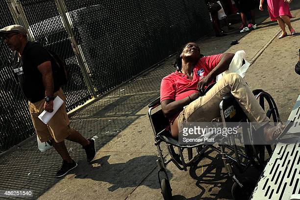 People walk in an area which has witnessed an explosion in the use of K2 or 'Spice' a synthetic marijuana drug in East Harlem on September 02 2015 in...