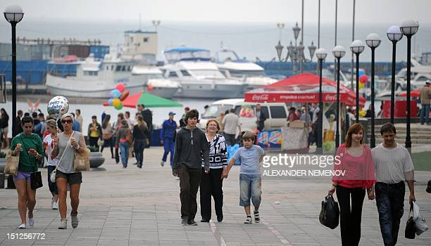 People walk in central Vladivostok where the AsiaPacific Economic Cooperation summit will take place on September 5 2012 APEC leaders' summit in...