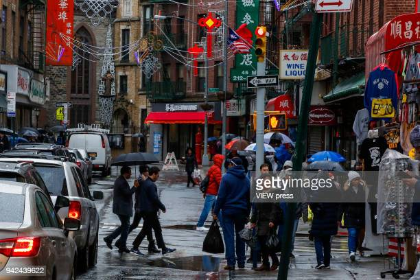 People walk in Chinatown on April 4 2018 in New York City China and USA announced tariffs on more than $100 billion of combined goods Chinese...