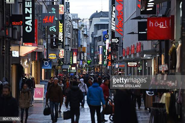 People walk in Cologne's main shopping street 'Hohe Strasse'in Cologne western Germany on January 13 2016 / AFP / PATRIK STOLLARZ