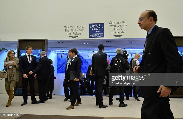 People walk in Congress Center on the opening day of the 45th Annual Meeting of the World Economic Forum in Davos Switzerland on January 21 2015 The...
