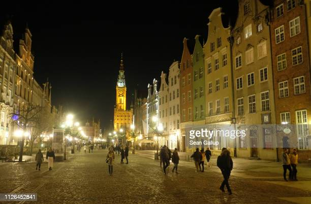 People walk in Dlugi Targ street on January 17 2019 in Gdansk Poland While Gdansk was heavily damaged during World War II its historic city center...