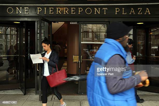 People walk in front of a building which according to reports is to be the future headquarters for the presidential campaign of Hillary Clinton on...