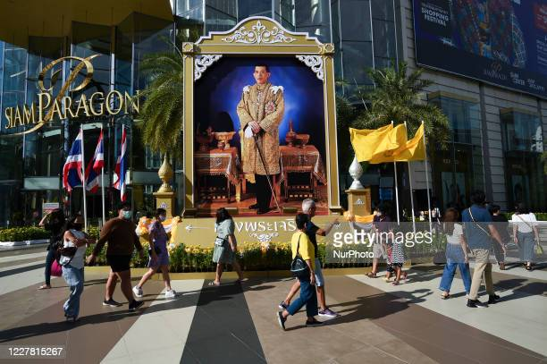 People walk in front of a portrait of Thai King Maha Vajiralongkorn in shopping mall in Bangkok, Thailand 28 July 2020.