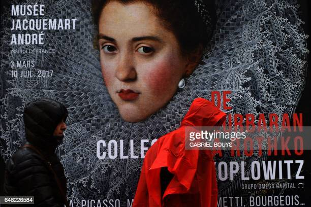 People walk in front of a poster of the exhibition 'From Zurbaran to Rothko Collection Alicia Koplowitz' at the Andre Jacquemart museum in Paris on...