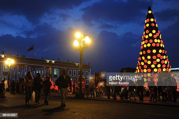 People walk in front of cathedral in Bolivar square with Christmas decorations in the old part of the city Bogota formerly called Santa Fe de Bogota...