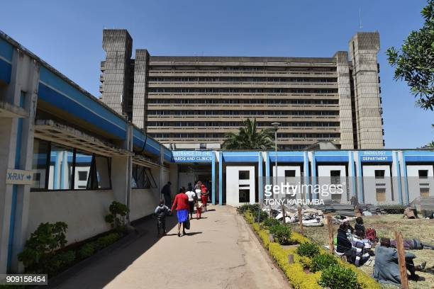 People walk in front of Kenya's oldest hospital Kenyatta National Hospital on January 23 2018 in Nairobi KNH was founded as the Native Civil hospital...