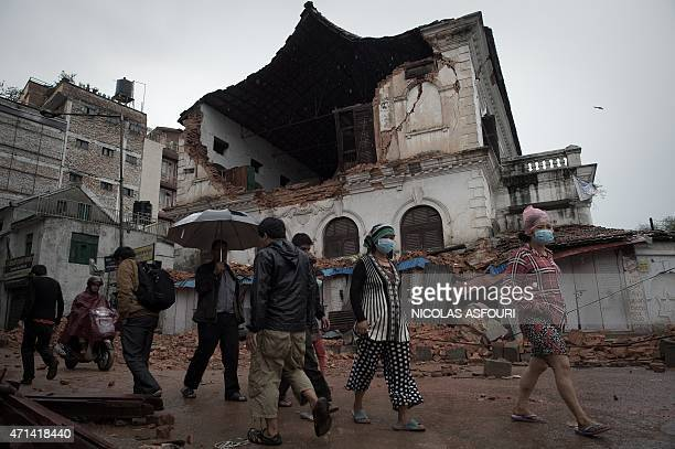 People walk in front of one of the oldest high schools in Kathmandu which was damaged in the earthquake on April 28 2015 Hungry and desperate...