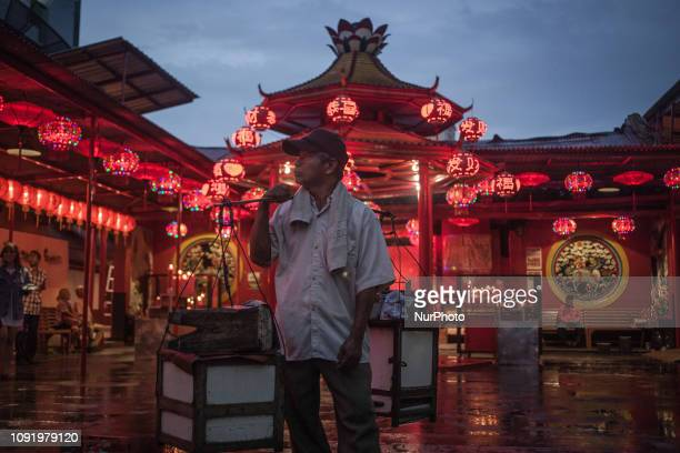 People walk in front of red lanterns for the upcoming Spring Festival at Chinese temple on January 31 2019 in Jakarta Indonesia The Spring Festival...