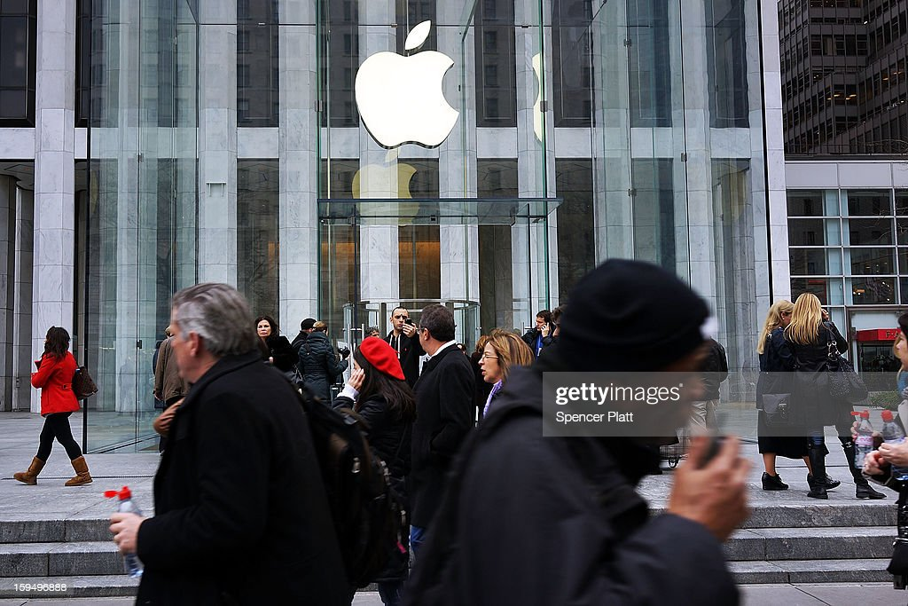 People walk in front of the 5th Avenue Apple store on January 14, 2013 in New York City. Responding to weaker than expected demand, Apple has cut orders for LCD screens and other parts for the iPhone 5 this quarter. Shares for the tech company fell more than 4 percent to $498.20 before the bell on Monday. Analysts see the slowing sales as evidence that the U.S. firm is losing ground to Asian smartphone rivals.
