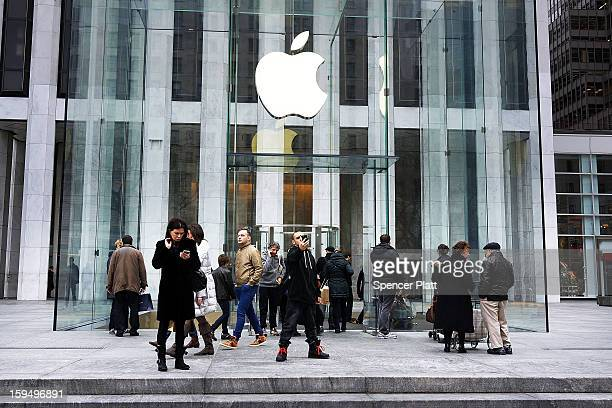 People walk in front of the 5th avenue Apple store on January 14 2013 in New York City Responding to weaker than expected demand Apple has cut orders...
