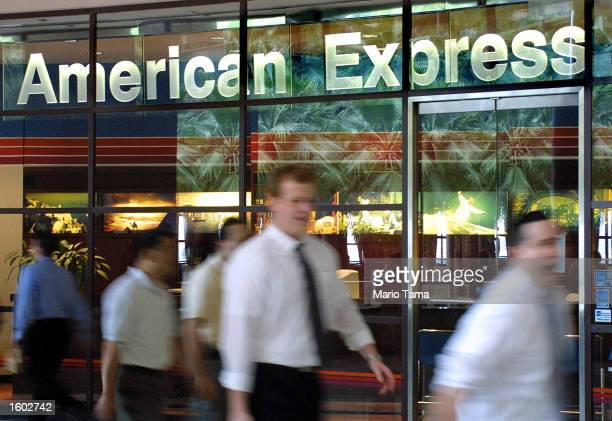 People walk in front of the American Express corporate headquarters July19 2001 in New York City The financial services company announced July 18...