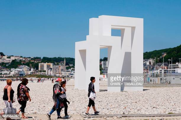 People walk in front of the art installation 'Up#3' by Sabina Lang and Daniel Baumann installed for the celebration of the 500th anniversary of the...