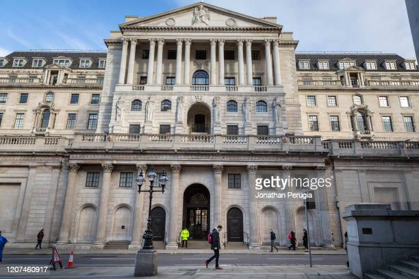 People walk in front of the Bank of England in what would normally be the morning rush hour in the City of London on March 17th 2020 The financial...
