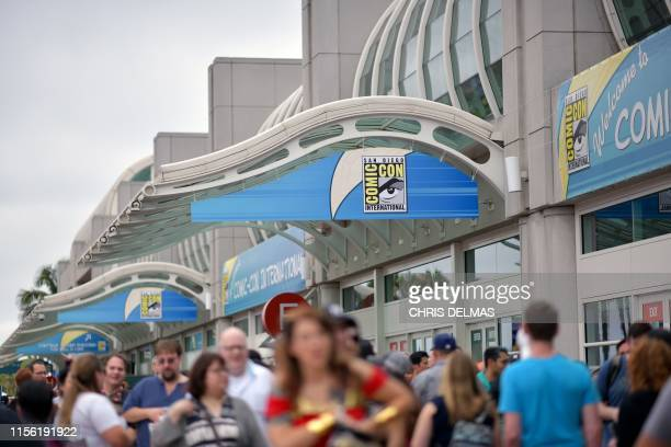 People walk in front of the Convention Center during Comic Con in San Diego, California on July 17, 2019.
