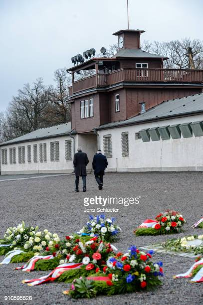 People walk in front of the former main entrance to the Buchenwald concentration camp on January 26 2018 near Weimar Germany International Holocaust...