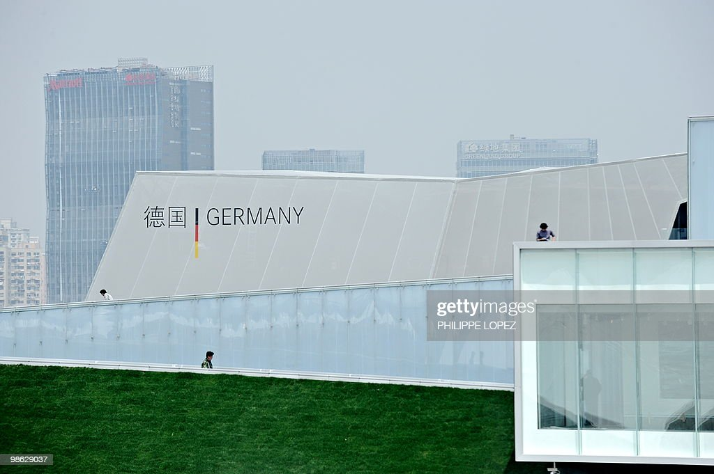 People walk in front of the German pavilion at the site of the World Expo 2010 in Shanghai on April 23, 2010. Expo organisers gave members of the public a preview of the largest-ever World's Fair as they tested facilities and public transportation before the official start on May 1.