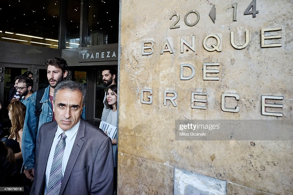 People walk in front of the Headquater Building of the National Bank on June 22, 2015 in Athens, Greece. The European Union welcomed new proposals from the Greek government after talks today to haul Athens back from the brink of bankruptcy.