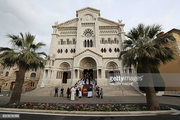 People walk in front of the Monaco Cathedral during the SainteDevote festivities on January 27 2017 in Monaco Saint Devote is the patron saint of the...