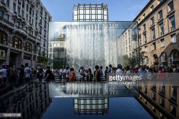 TOPSHOT People walk in front of the new Apple Store Liberty the first Italian flagship store of Apple in Milan on July 26 2018