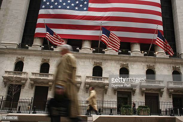 People walk in front of the New York Stock Exchange January 22 2008 in New York City Following a sharp fall in international markets Monday the...