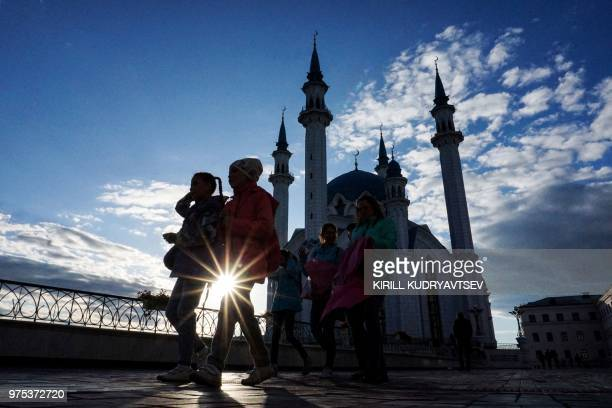 People walk in front of the Qol Sharif mosque in the Kazan Kremlin in central Kazan on June 15 during of the Russia 2018 World Cup football tournament