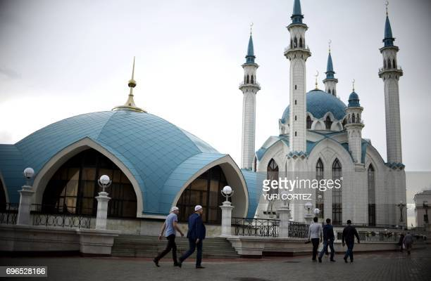 People walk in front of the Qolsarif Mosque while visiting the Kremlin in Kazan Russia on June 16 ahead of the 2017 Russia Confederations Cup...