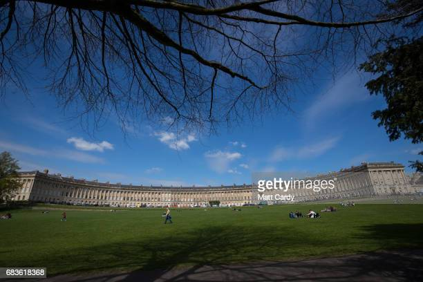 People walk in front of the Royal Crescent on April 19 2017 in Bath England Designed by the architect John Wood the Younger and built between 1767...