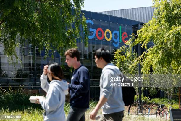 People walk in Google's main campus as a sit-in to protest against Google's retaliation against workers takes place within Google's main cafeteria in...