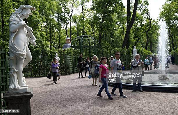 People walk in Letny Sad park St Petersburg on May 28 2012 The Summer Garden the jewel of St Petersburg celebrated by poets Alexander Pushkin and...