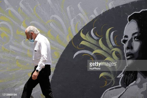 People walk in Mexico City Mexico on May 18 2020 during the coronavirus emergency