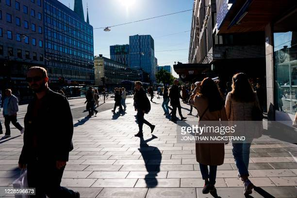 People walk in Stockholm on September 19 during the novel coronavirus COVID-19 pandemic.