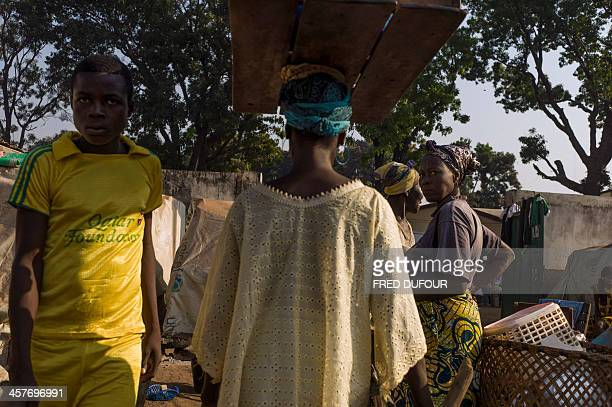 People walk in the Christian camp for internally displaced people in Bossangoa on December 18 2013 The Central African Republic's interim president...