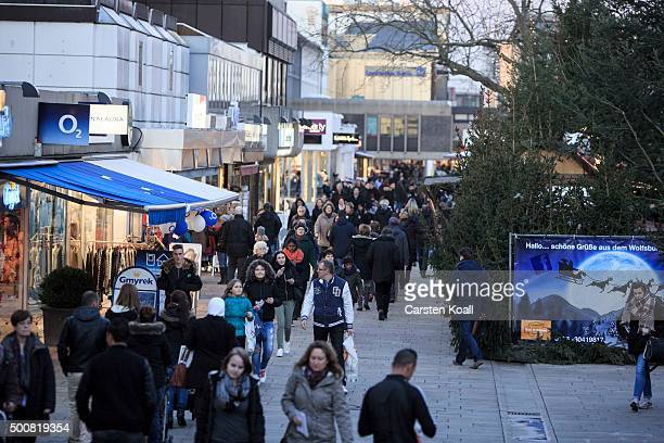 People walk in the city center on December 10 2015 in Wolfsburg Germany Wolfsburg is the base for the car manufactury Volkswagen group Volkswagen is...